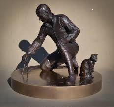 Fig.3 Flinders, compasses in hand, and Trim on the watch, crouch together over the map of Australia: elegantly apt statue by Mark Richards, installed at Euston Station with copy also at Tasman Terrace, Port Lincoln, Australia.